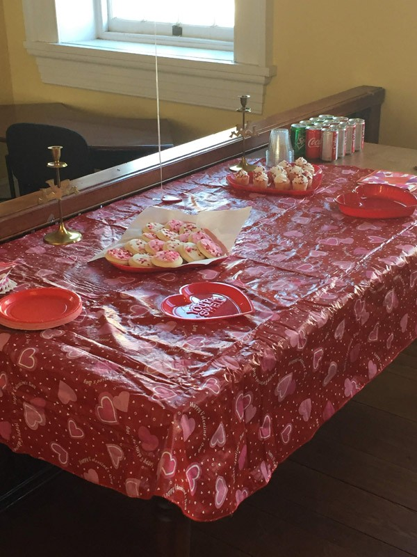 Valentine table setting with cookies and cupcakes