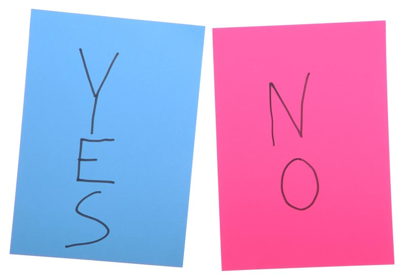 yes and no on colored pieces of paper